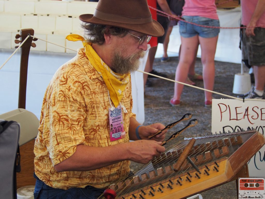 Doc Terry plays the Hammered Dulcimer in the Philadelphia Folksong Society tent at the Philadelphia Folk Festival.