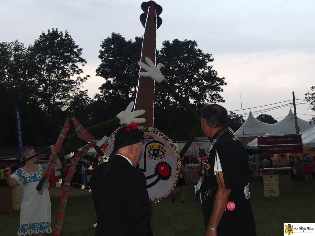 Dennis Hangey inspects Jo the Smiling Banjo at the 57th annual Philadelphia Folk Festival.