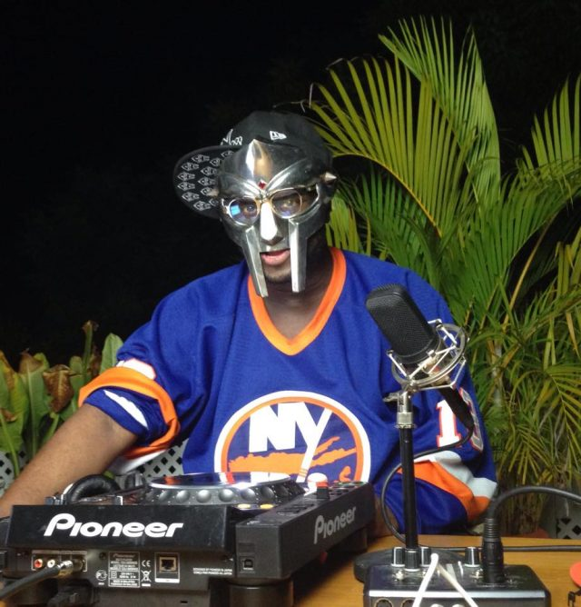 MF Doom wearing his mask and a New York Islanders sweater.