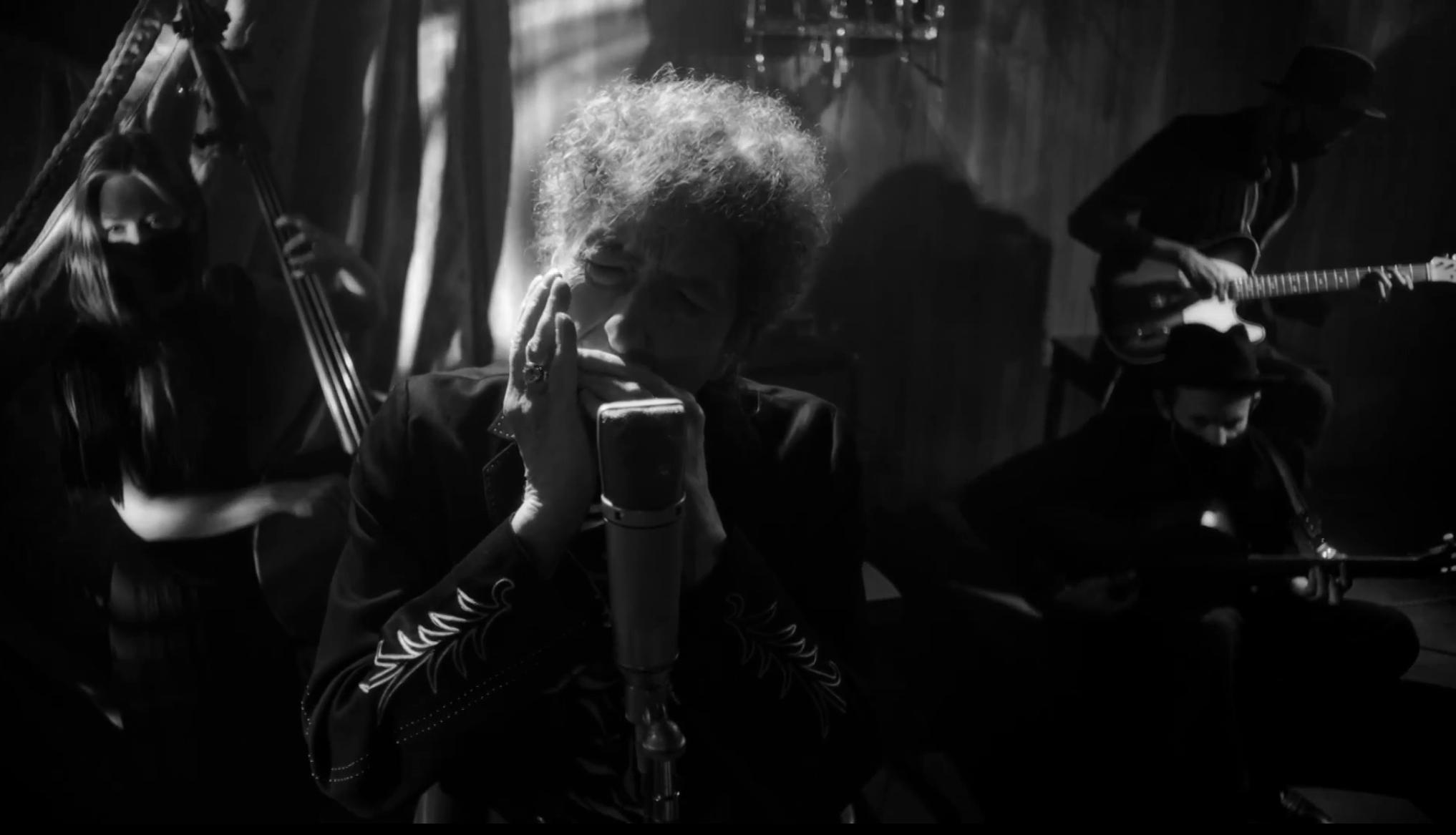 "Bob Dylan still masters the harmonica during ""Shadow Kingdom."""